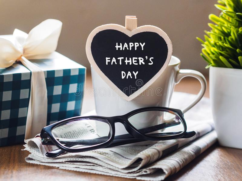 Happy fathers day concept. coffee cup with gift box, heart tag w stock photo