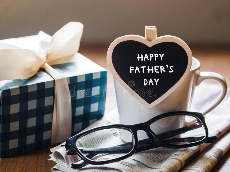 Happy fathers day concept. coffee cup with gift box, heart tag w royalty free stock images
