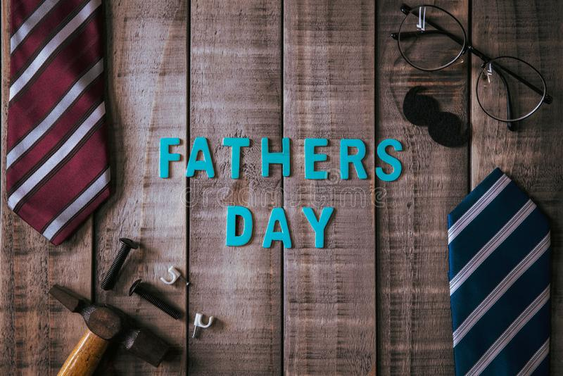 Happy fathers day concept. Top view of mamy tools and ties, retro glasses on dark wooden table background. Flat lay stock image