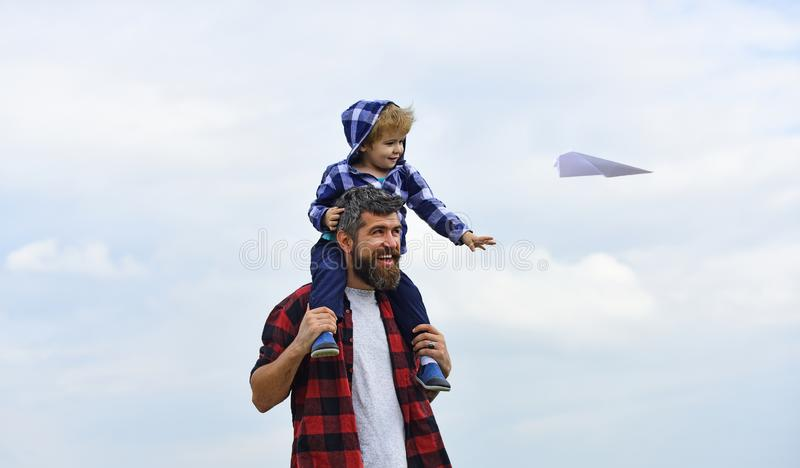 Happy fathers day. Dad and son are playing on sky background. Happy father giving son back ride on sky in summer. Carefree royalty free stock images