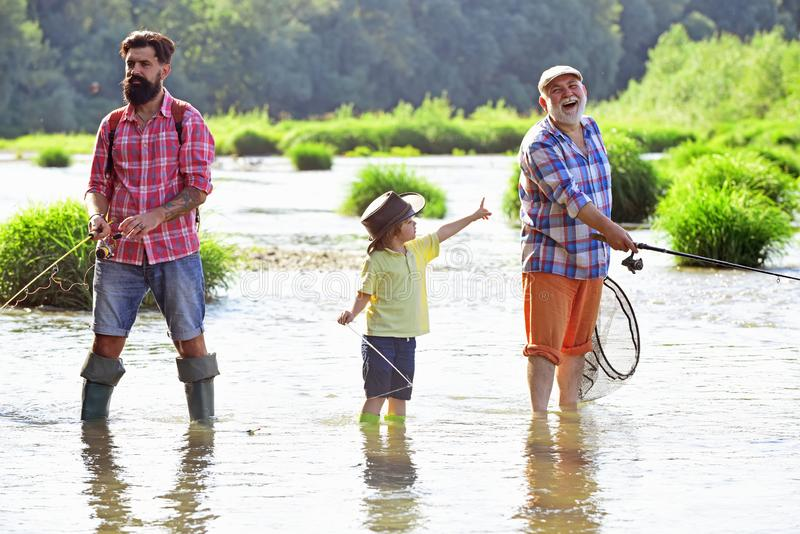 Happy fathers day. Great-grandfather and great-grandson. Outdoors active lifestyle. I love fishing. Father and son stock photos