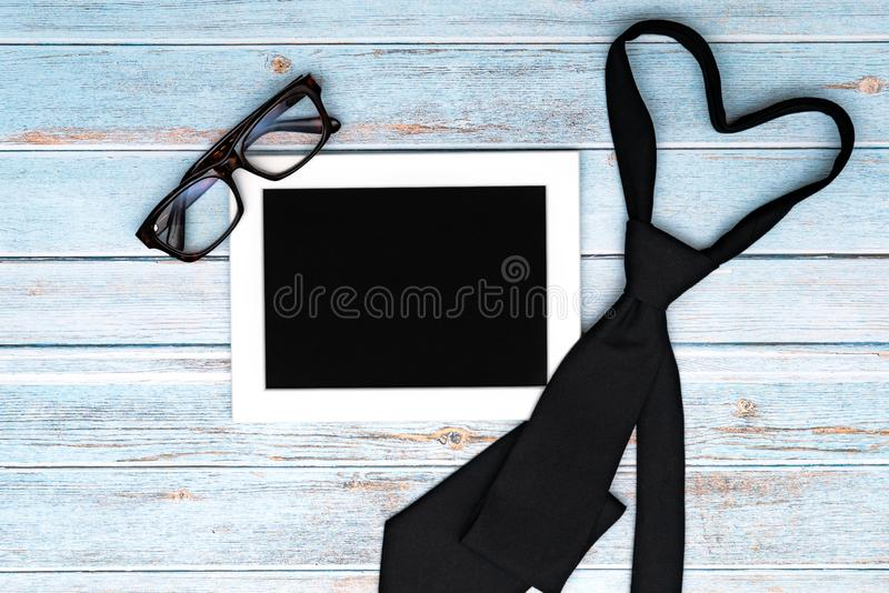 Happy fathers day greeting card with necktie and glasses on wooden table, Flat lay style stock photos