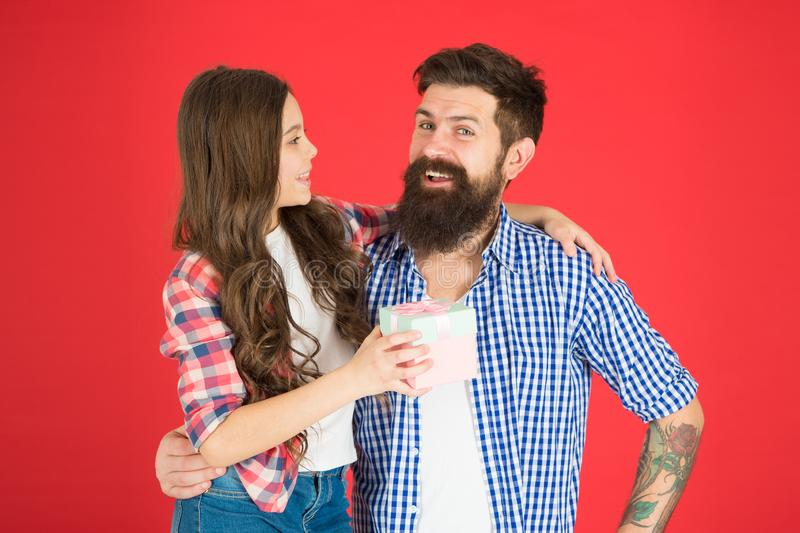 Happy fathers day. Man bearded father and cute little girl daughter on red background. Celebrate fathers day. Family. Values concept. Friendly relations. Father stock photo
