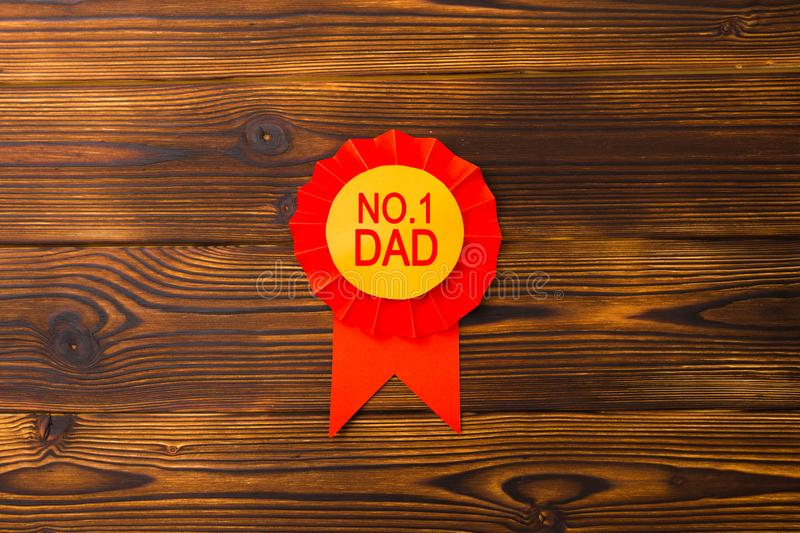 Happy fathers day red label with ribbons. Reward for a best father. Image royalty free stock photos