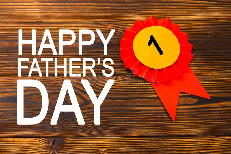 Happy fathers day red label with ribbons. Reward for a best father. Image royalty free stock photo