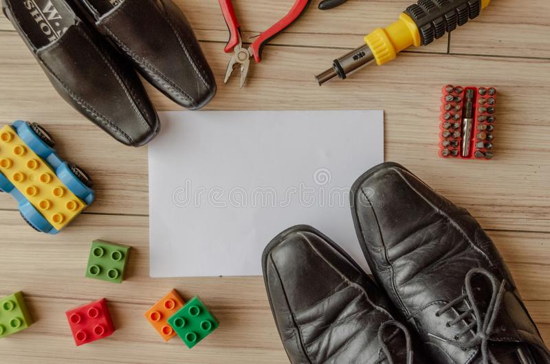 Happy fathers day, fathers shoes and baby boys shoes overhead, flat lay.  royalty free stock images