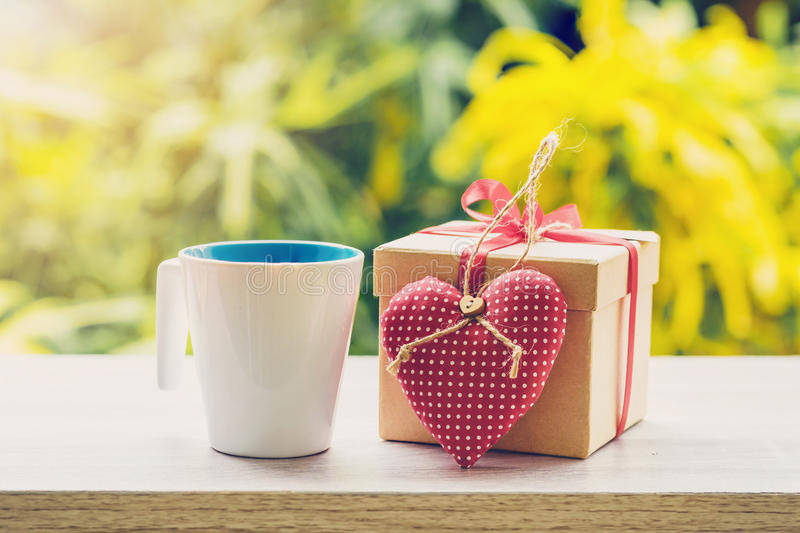 Happy fathre's day concept coffee cup and gift box and heart o royalty free stock images
