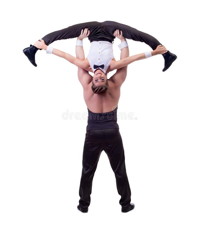 Happy female acrobat posing with her partner. Cheerful female acrobat posing with her partner, isolated on white stock photos