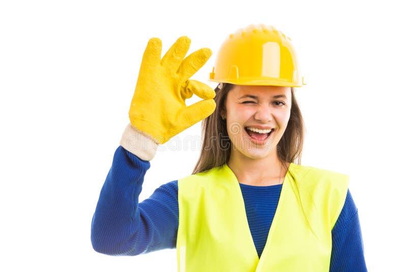 Happy female architect winking and showing ok royalty free stock photo