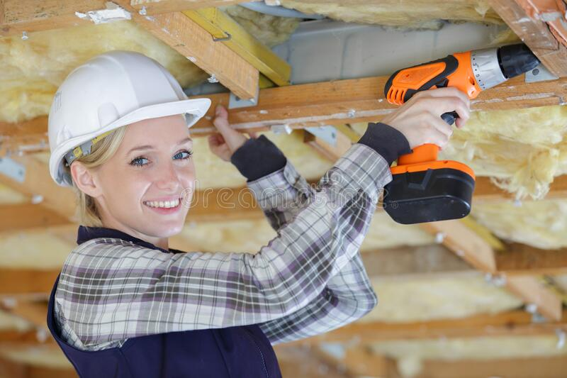 Happy female construction using drill royalty free stock photos