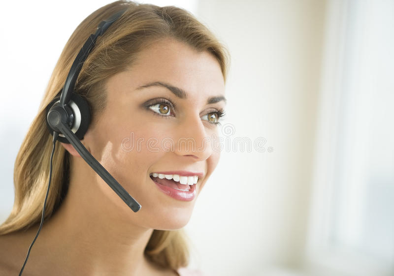 Happy Female Customer Service Representative Looking Away royalty free stock images