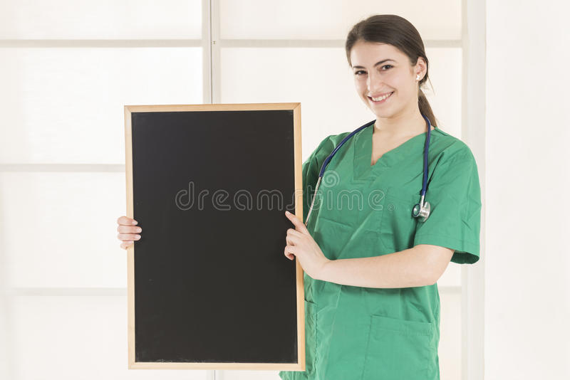 Happy Female Doctor Holding blackboard royalty free stock images