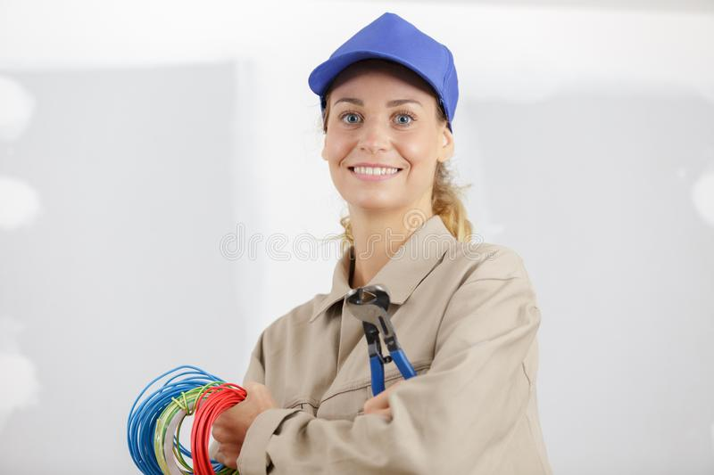 Happy female electrician fixing electricity problem royalty free stock photos