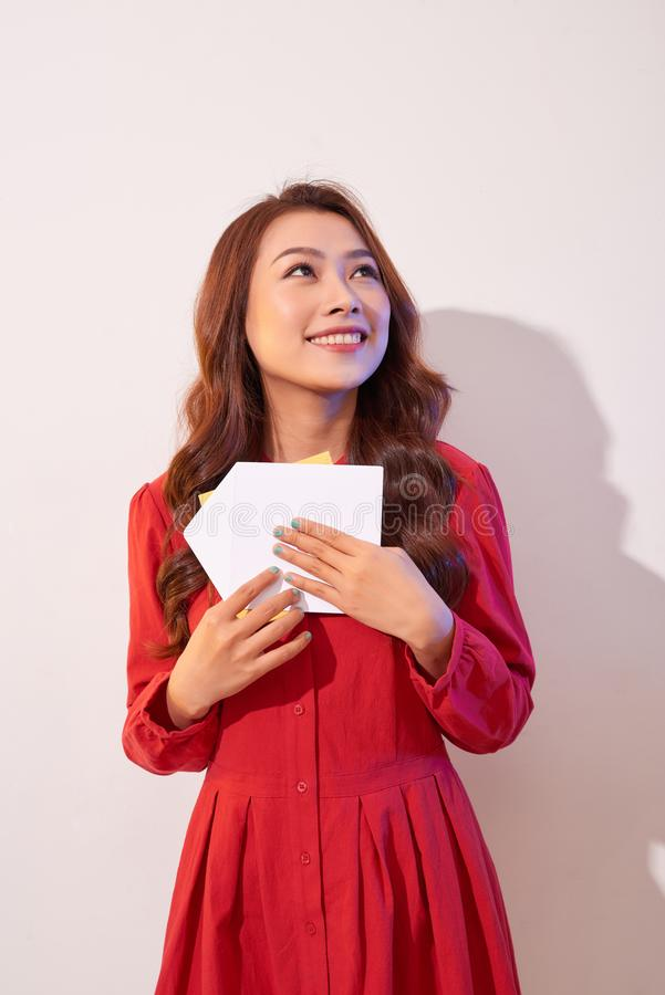 Happy female enjoying greeting card, reading with pleasure love letter, celebrate Valentine day at home stock image