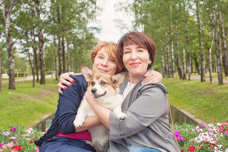 Happy female family with dog pet outdoor, lifestyle portrait royalty free stock image