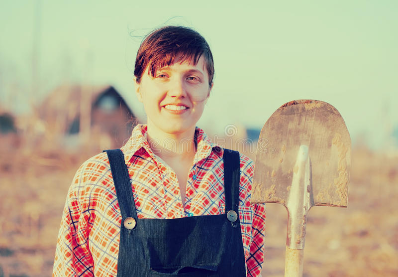 Happy female farmer. With spade in rural royalty free stock photography