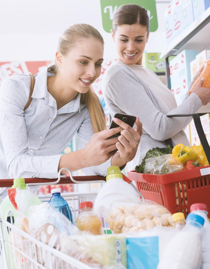 Friends shopping together royalty free stock photos