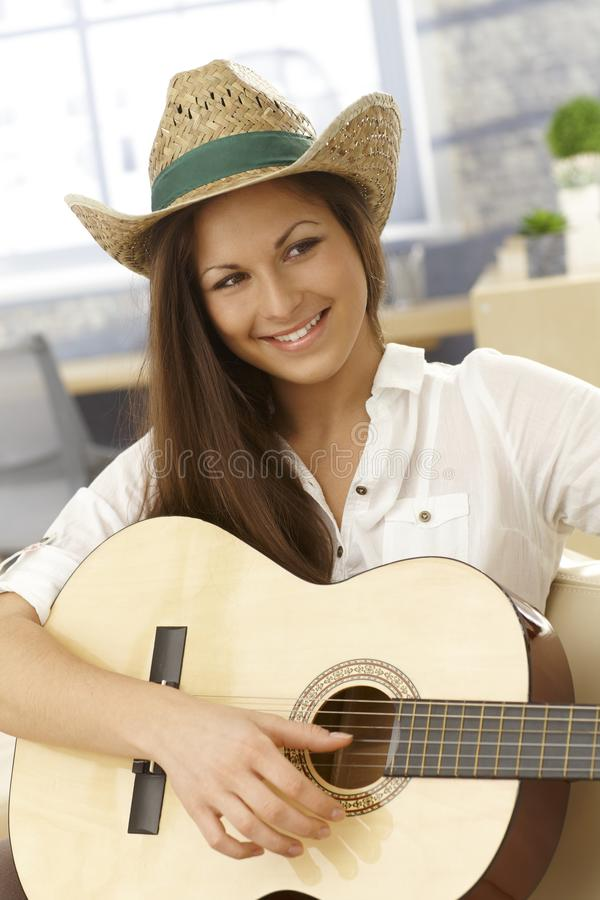 Happy female guitar player royalty free stock images