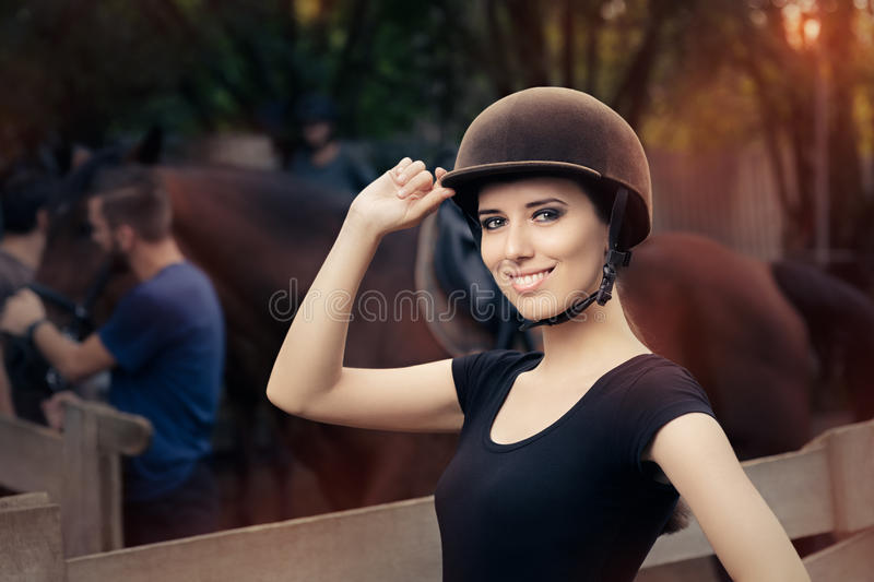 Happy Female Jockey Smiling. Confident woman ready to ride a horse royalty free stock image