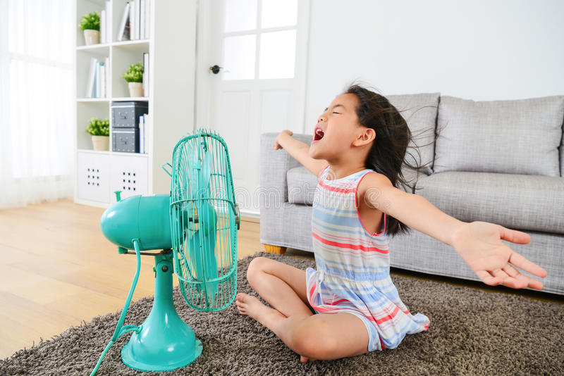Happy female kid opening arms enjoying cool wind royalty free stock images