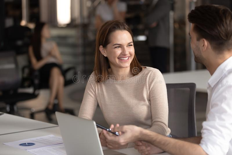 Happy female manager listening to confident male team leader. royalty free stock images