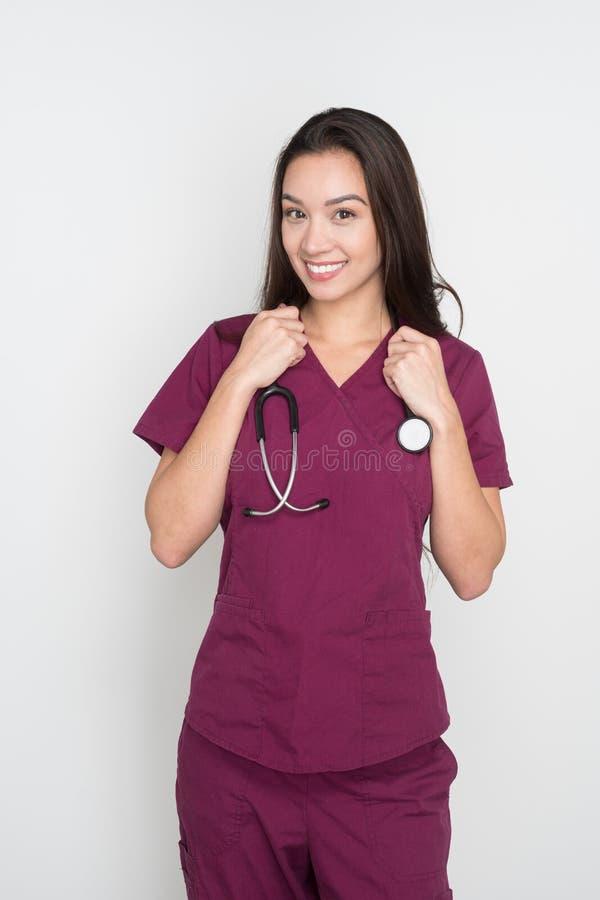 Nurse In Scrubs. Happy female nurse posing in her scrubs stock images