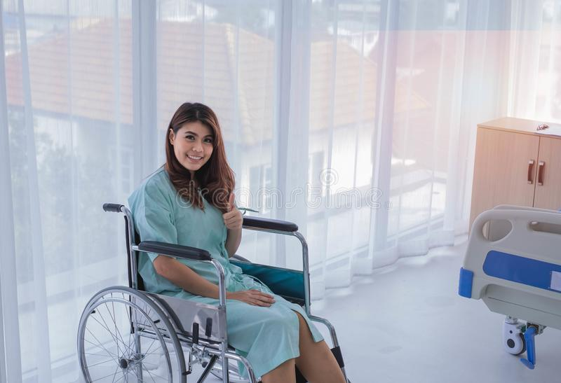 Happy female patient in hospital room royalty free stock image