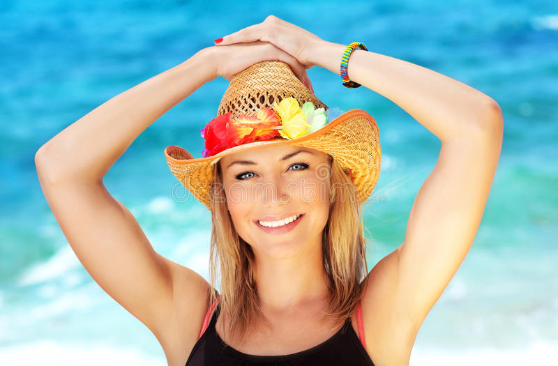 Happy female portrait on the beach royalty free stock photo