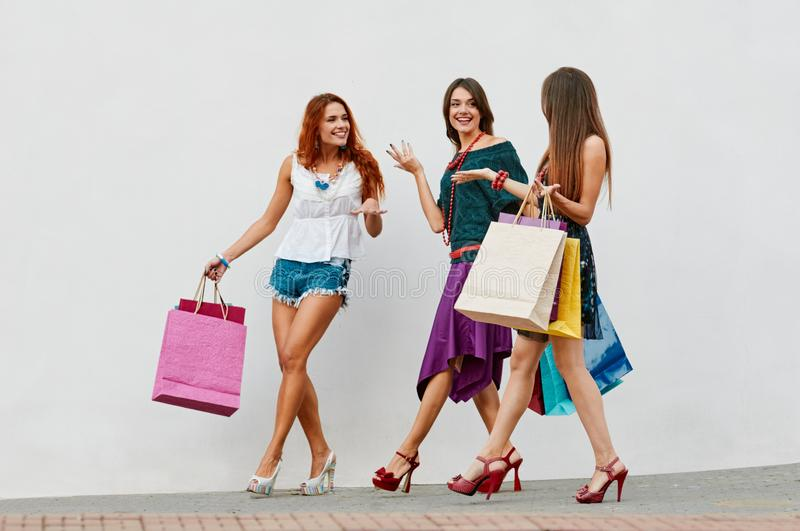 Happy female shoppers stock photo