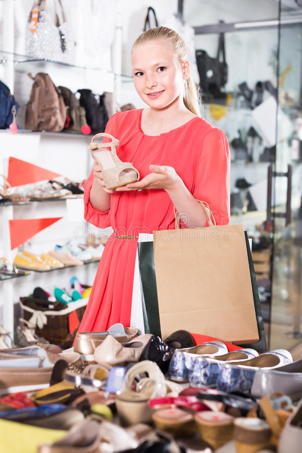 Happy female is showing summer brilliant shoes royalty free stock photo