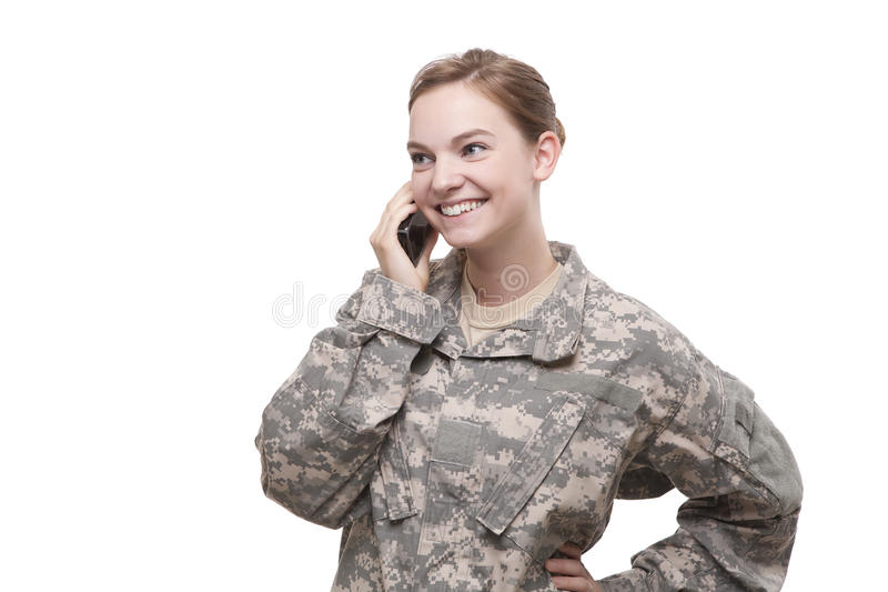 Happy female soldier talking on mobile phone royalty free stock photography