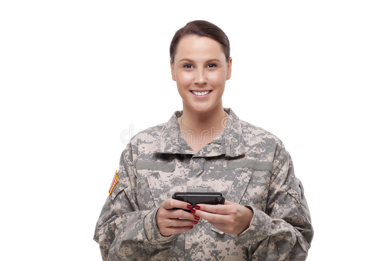 Happy female soldier using mobile phone royalty free stock images