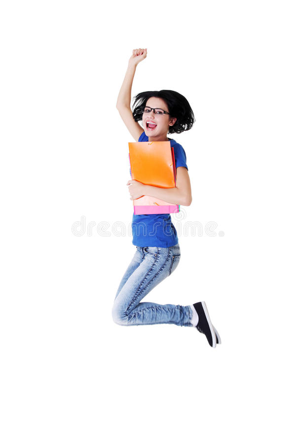 Download Happy Female Student Jumping With A Notebook Royalty Free Stock Photo - Image: 28205155
