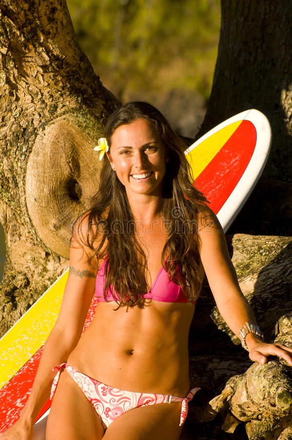 Happy female surfer royalty free stock photography