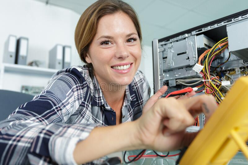 Happy female technician fixing pc royalty free stock images