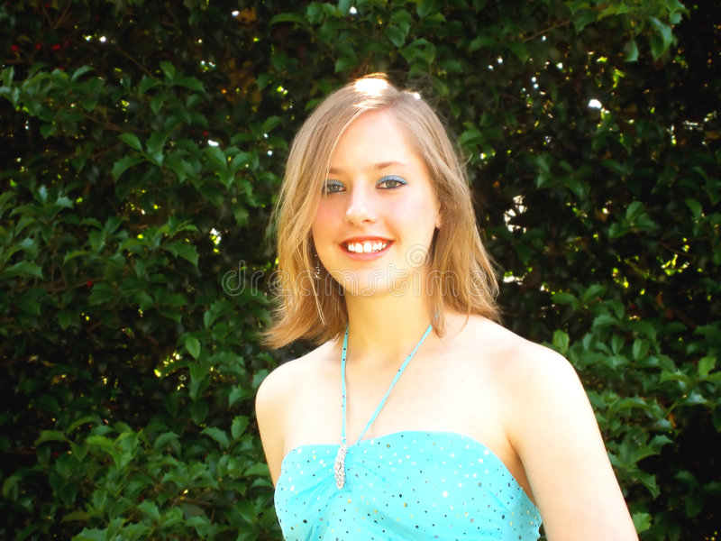 Happy female teen in dress stock photo