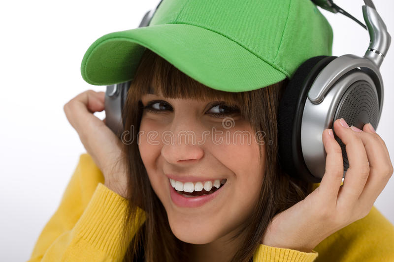 Download Happy Female Teenager Enjoy Music Stock Photo - Image of yellow, cute: 13449324
