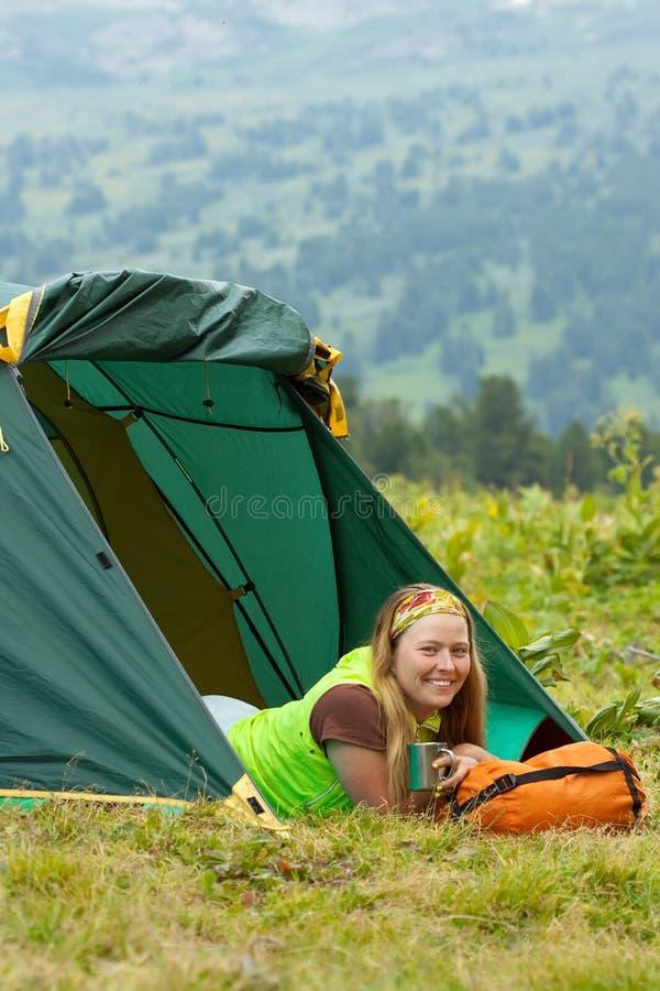 Happy female tourist drinking tea stock photo