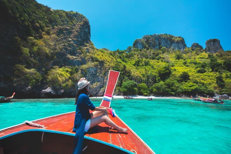 Happy female traveling on boat stock photography