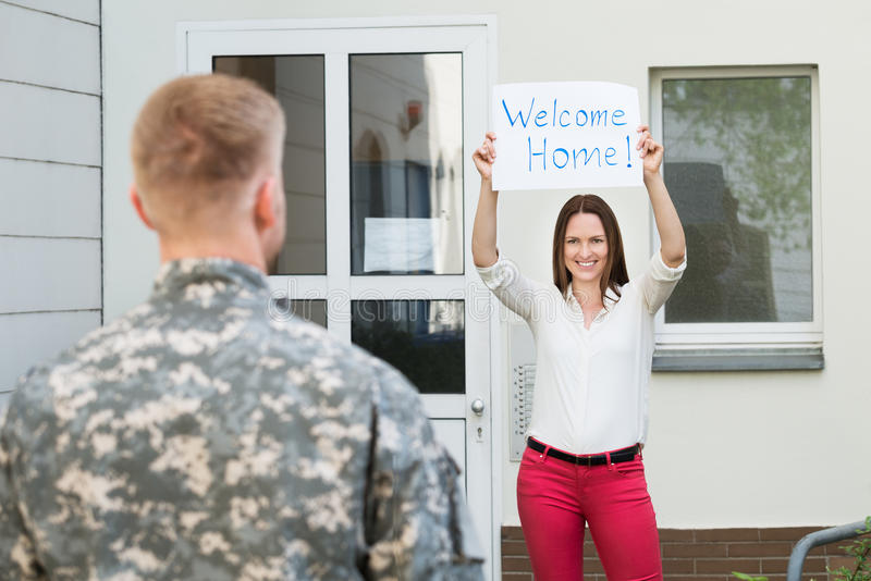 Wife Welcoming Her Husband Home royalty free stock photos