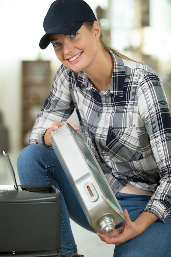 Happy female worker looking at camera. Woman royalty free stock photography