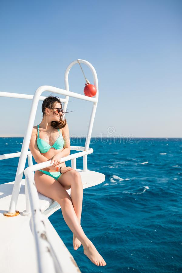 Happy female yachting tourist, having fun on yacht, summertime sailing vacation, beautiful woman outdoor on sailboat, fit bod stock photos