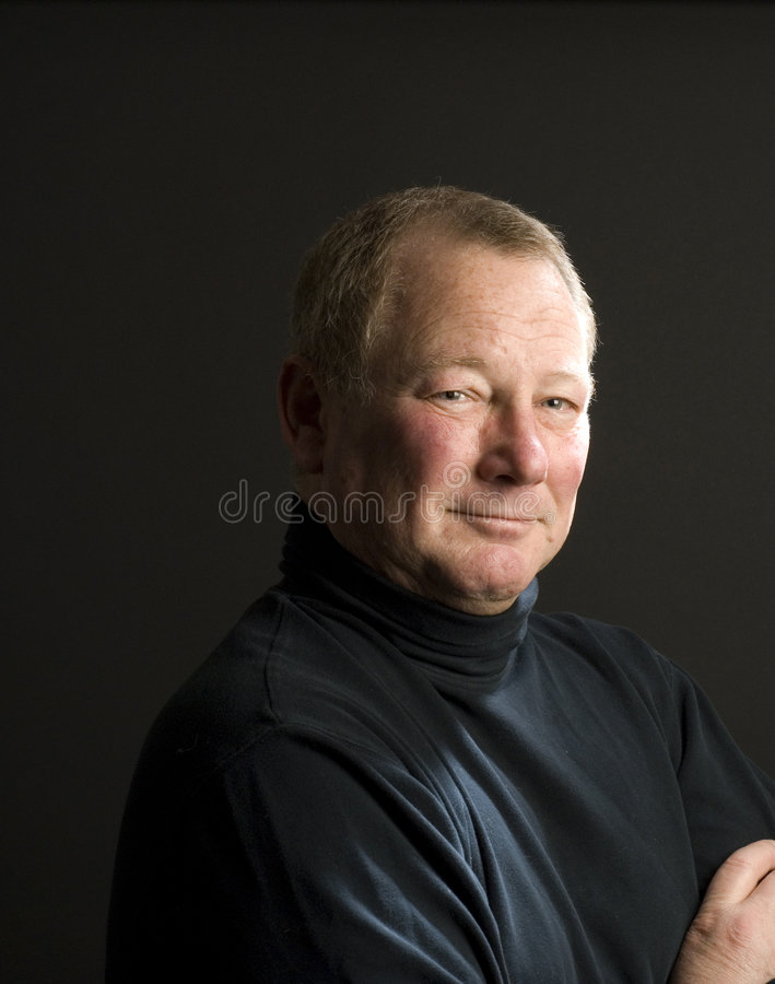 Happy fifty year old guy stock image