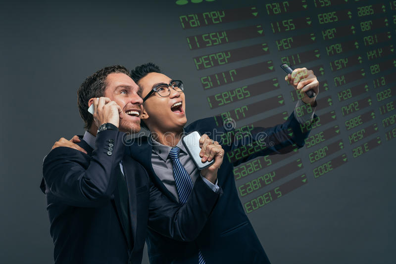 Happy financial brokers royalty free stock photography