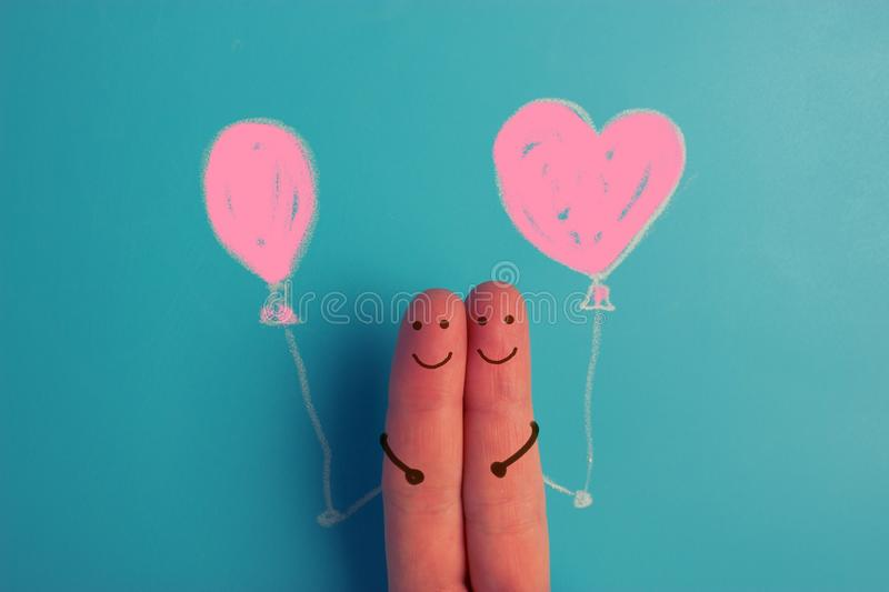 A happy fingers couple in love with painted smiley and hugging royalty free illustration