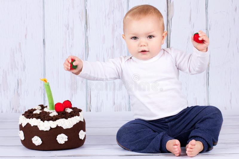 Happy first birthday. Studio portrait of cute toddler and a birthday cake royalty free stock photos