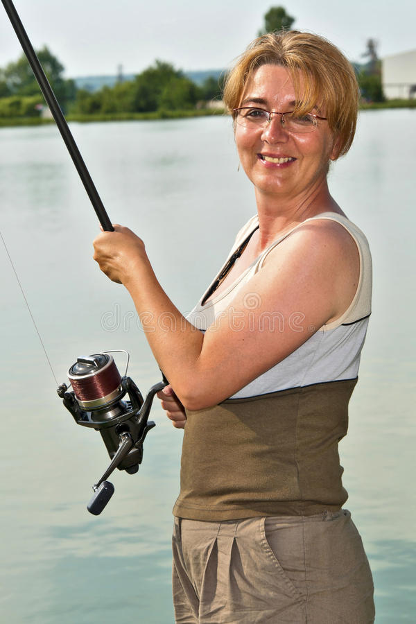 Happy fisherwoman stock images