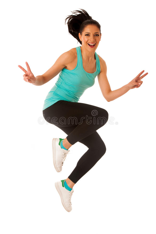 Happy fit and slim woman dancing and jumping isolated over white royalty free stock images
