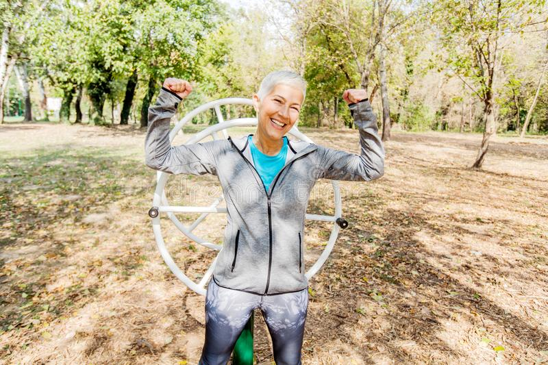 Happy Fit Successful Senior Woman Raised Arms At Outdoor Gym royalty free stock images