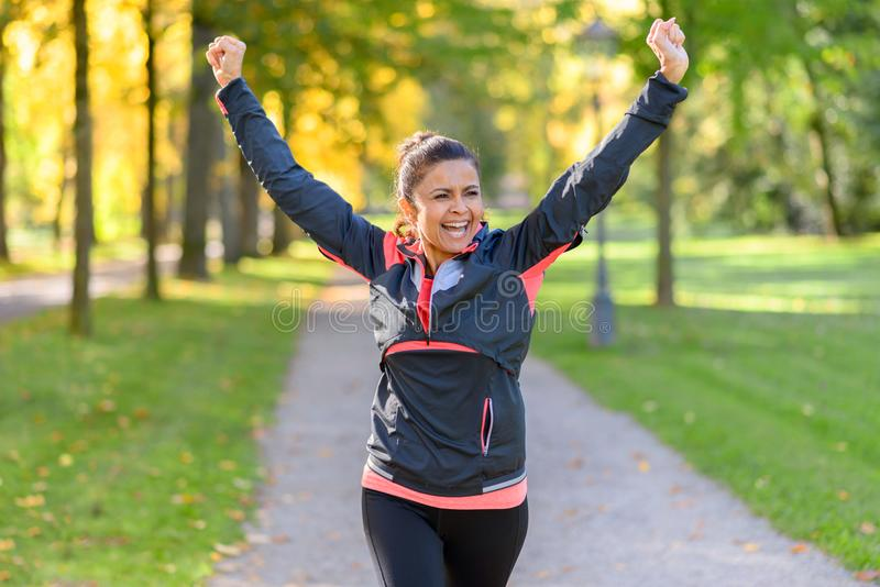 Happy fit woman cheering and celebrating stock images